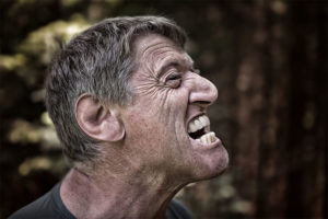 Man grimacing from tooth pain